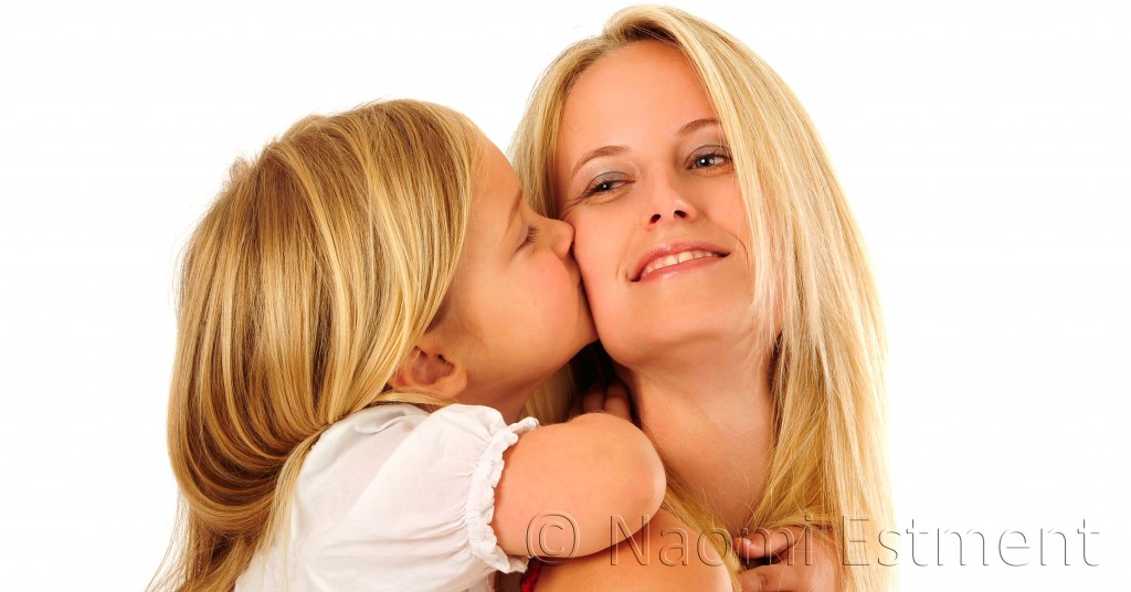 Daughter kissing Mom
