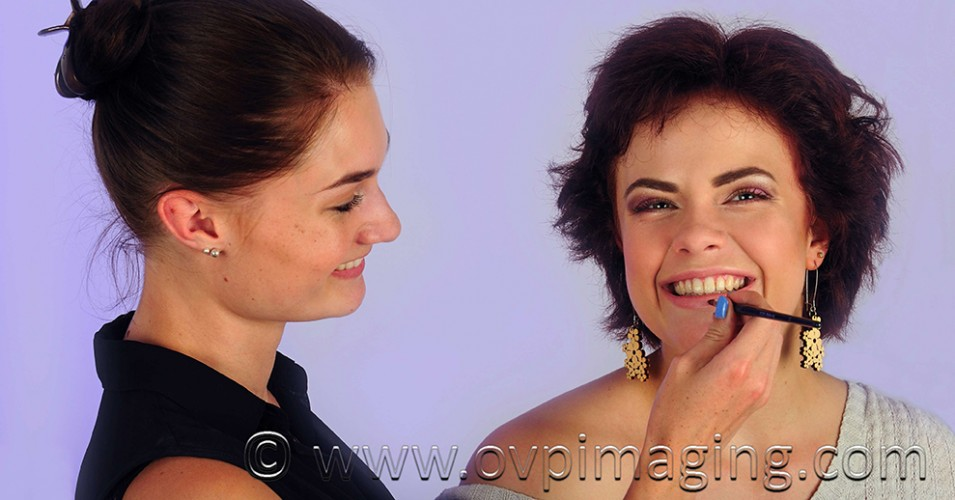 Professional make-up artist with model in studio